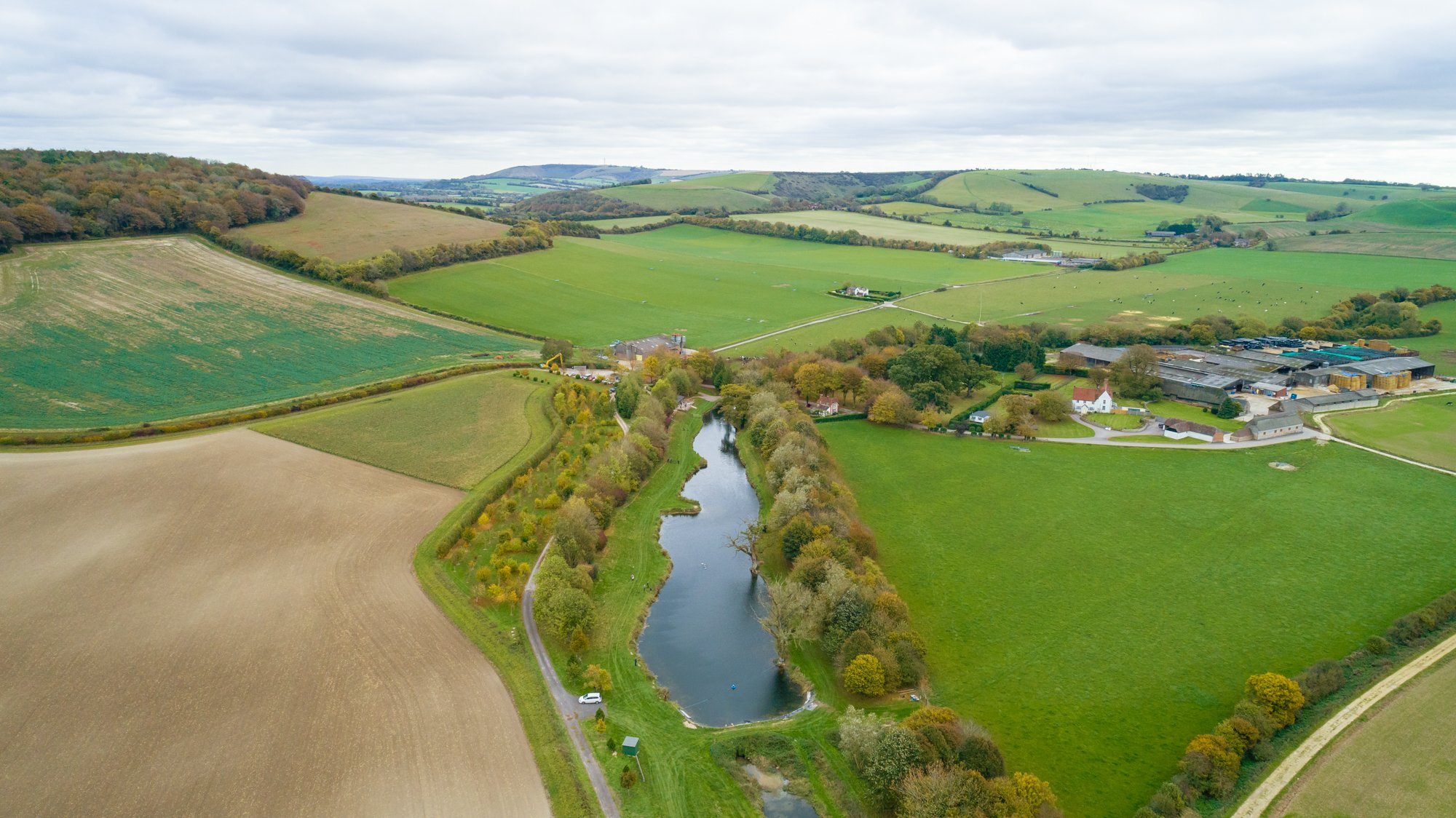 An aerial photograph of the fishing lake at Meon Springs
